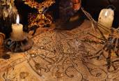 71577197-close-up-of-demon-parchment-magic-objects-and-candles-halloween-concept-occult-objects-on-table-ther